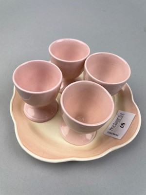 Lot 60 - A SUSIE COOPER EGG CUP STAND AND FOUR OTHER EGG CUPS