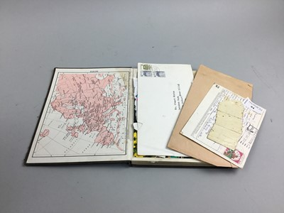 Lot 94 - A STAMP ALBUM ALONG WITH A FISHING ROD