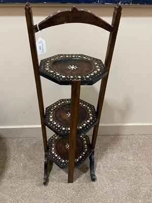 Lot 101 - AN EARLY 20TH CENTURY INDIAN THREE-TIER CAKE STAND