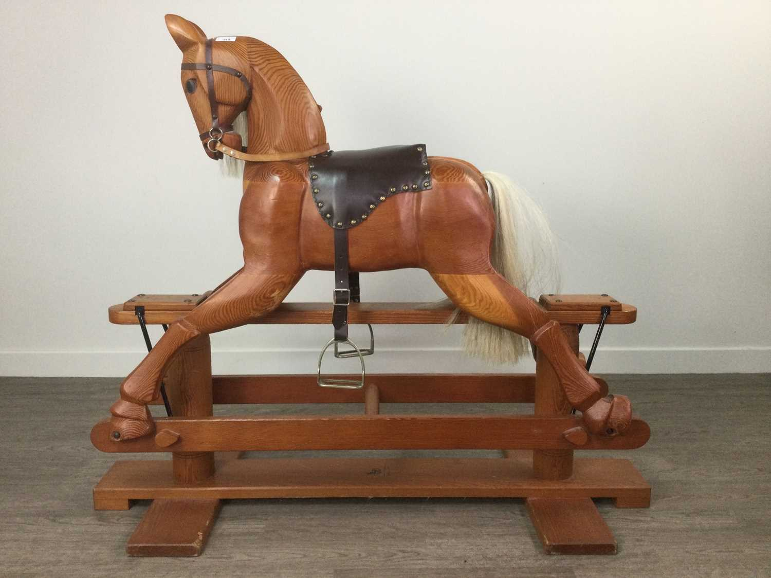 Lot 713 - A PINE CHILD'S ROCKING HORSE