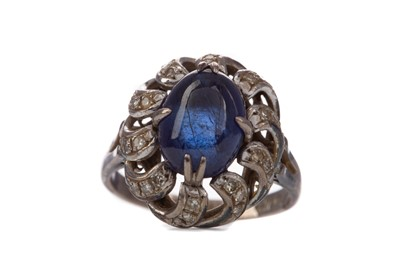 Lot 1310 - A SAPPHIRE AND DIAMOND RING