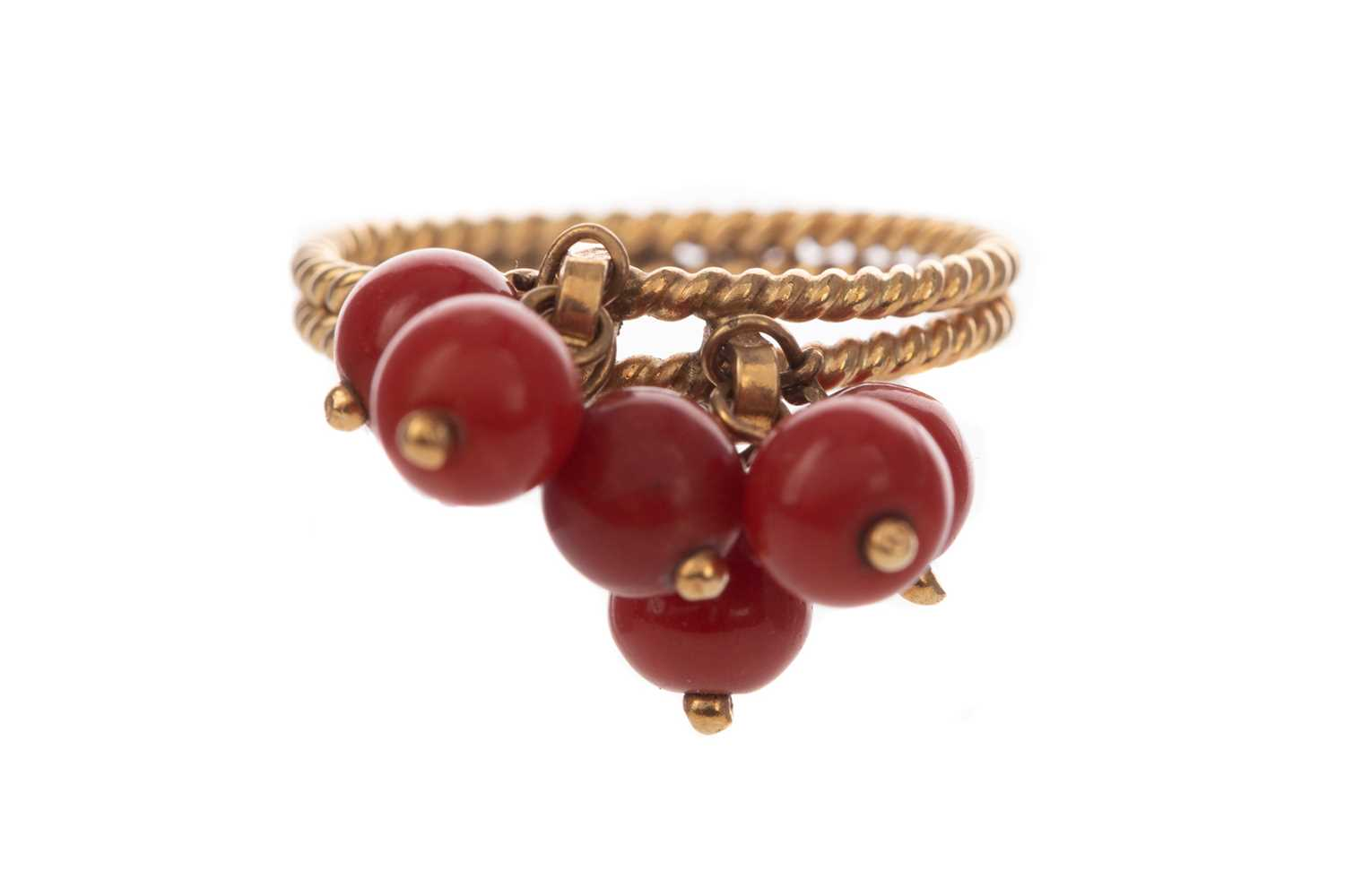 Lot 1308 - A CORAL BEAD RING
