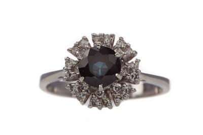 Lot 1317 - A  GEM SET AND DIAMOND RING