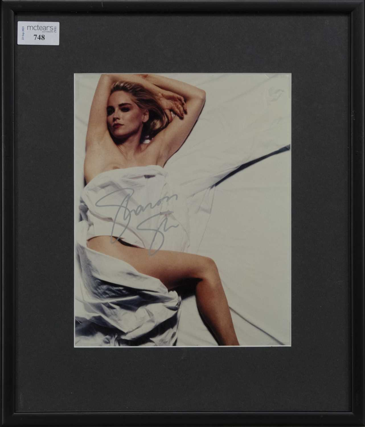 Lot 748 - A PHOTOGRAPH OF SHARON STONE