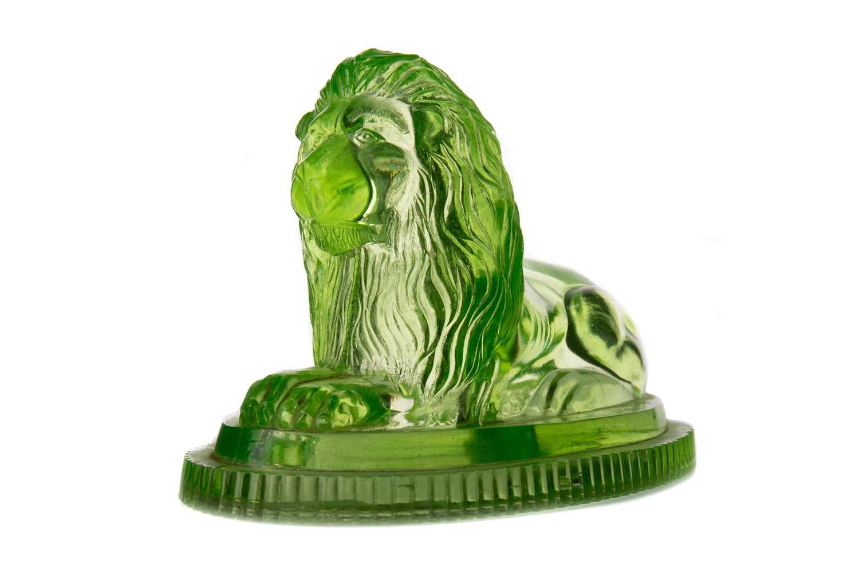 Lot 1029 - A LATE VICTORIAN URANIUM GLASS FIGURE OF A RECUMBANT LION