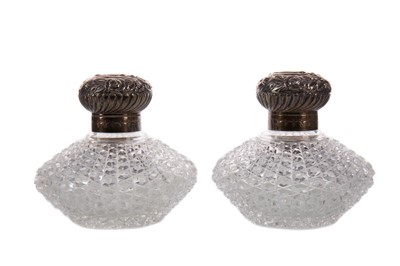 Lot 491 - A PAIR OF VICTORIAN SILVER MOUNTED CUT GLASS SCENT BOTTLES