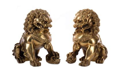 Lot 1850 - A PAIR OF 20TH CENTURY CHINESE GILT BRASS FOE DOGS