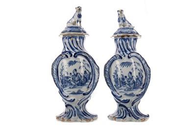 Lot 1055 - A PAIR OF 19TH CENTURY DUTCH DELFTWARE BLUE & WHITE VASES