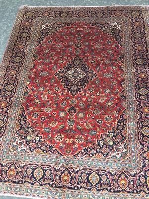 Lot 1831 - A PERSIAN HAND KNOTTED WOOL CARPET