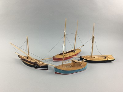 Lot 67 - A GROUP OF TEN PAINTED WOOD MODEL FISHING BOATS