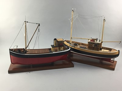 Lot 69 - A LOT OF TWO PAINTED WOOD MODEL FISHING BOATS