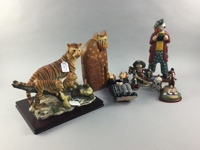 Lot 76 - A RESIN GROUP OF TIGERS, CLOWN AND OTHER FIGURES