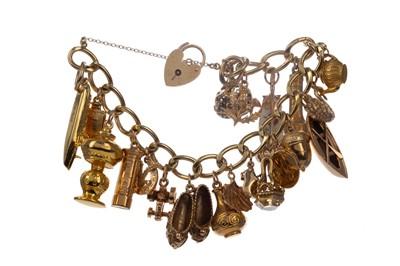 Lot 1359 - A GOLD CHARM BRACELET