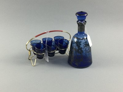 Lot 77 - A BLUE GLASS DECANTER AND SIX SHOT GLASSES