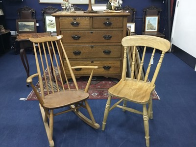 Lot 97 - AN ERCOL OAK ROCKING ARMCHAIR AND A SPINDLE BACK KITCHEN CHAIR