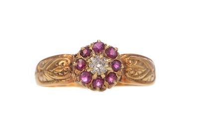 Lot 1414 - A RUBY AND DIAMOND CLUSTER RING