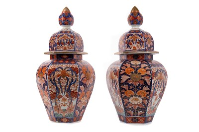 Lot 1827 - A PAIR OF JAPANESE IMARI HEXAGONAL VASES AND COVERS