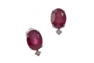 Lot 1353 - A PAIR OF RUBY AND DIAMOND STUD EARRINGS