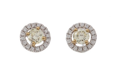 Lot 1365 - A PAIR OF CERTIFICATED YELLOW DIAMOND STUD EARRINGS