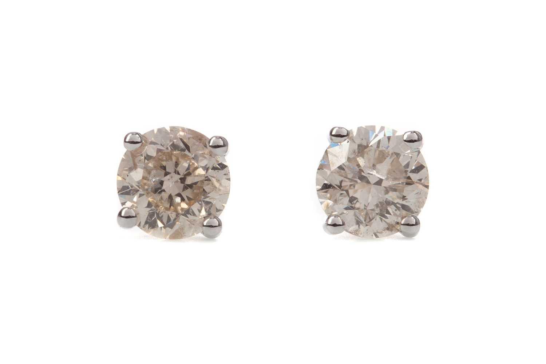 Lot 1366 - A PAIR OF DIAMOND STUD EARRINGS