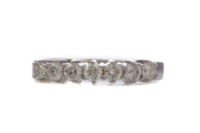 Lot 1378 - A CERTIFICATED DIAMOND SEVEN STONE RING