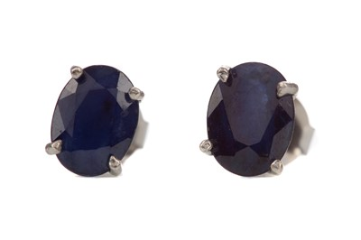 Lot 1413 - A PAIR OF TREATED SAPPHIRE STUD EARRINGS