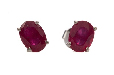 Lot 1415 - A PAIR OF TREATED RUBY STUD EARRINGS