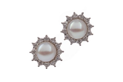Lot 1433 - A PAIR OF PEARL AND DIAMOND STUD EARRINGS