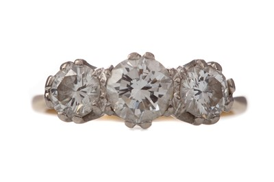 Lot 1550 - A DIAMOND THREE STONE RING