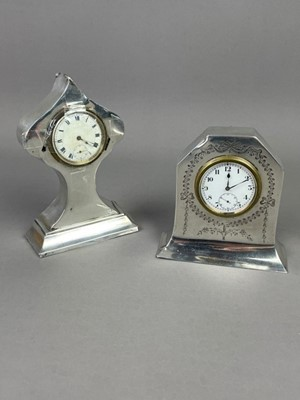 Lot A LOT OF TWO EARLY 20TH CENTURY SILVER CASED MANTEL CLOCKS