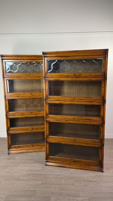 Lot 811 - A PAIR OF OAK SECTIONAL BOOKCASES