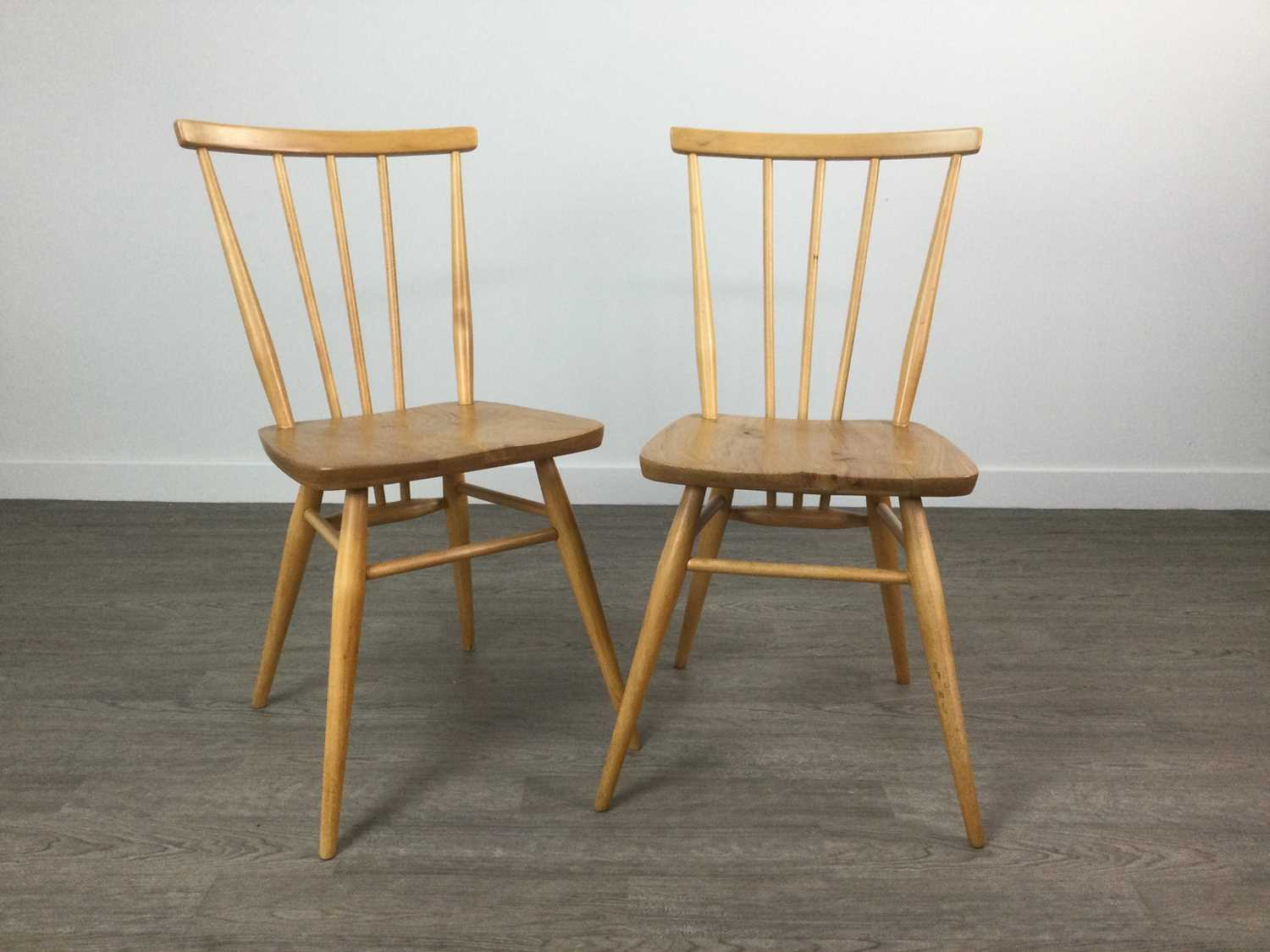 Lot A SET OF FOUR ERCOL CHILTERN PATTER SINGLE CHAIRS