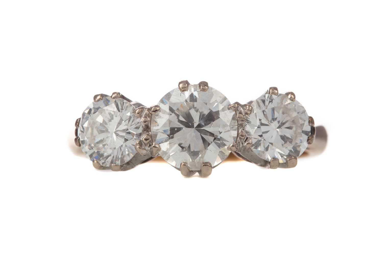 Lot 337 - A DIAMOND THREE STONE RING