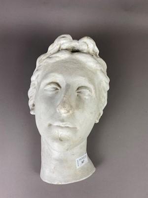 Lot A STUCCO SCULPTURE OF A FEMALE HEAD