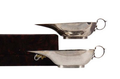 Lot 566 - A PAIR OF GEORGE VI SILVER SAUCE BOATS