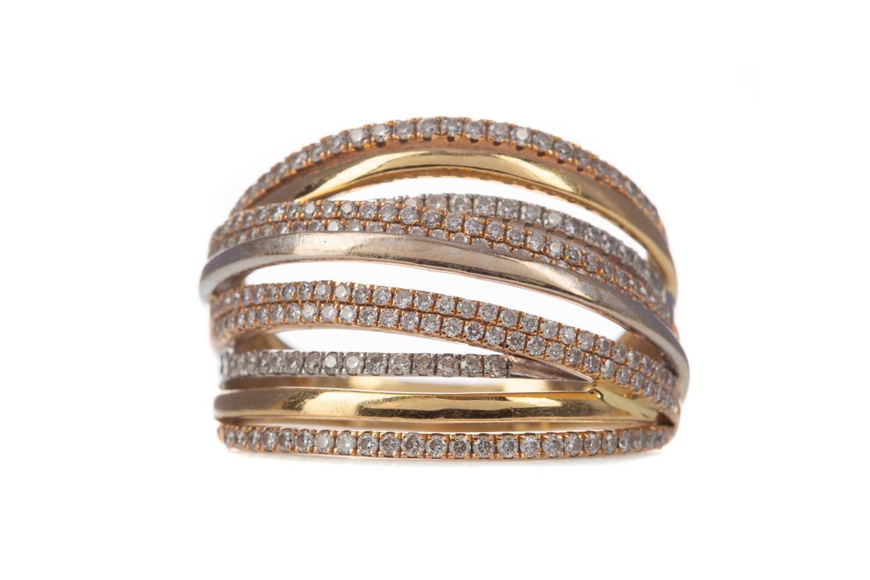 Lot 334 - A TRICOLOUR DIAMOND SET RING