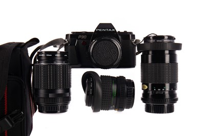 Lot 1108 - A PENTAX CAMERA ALONG WITH LENSES
