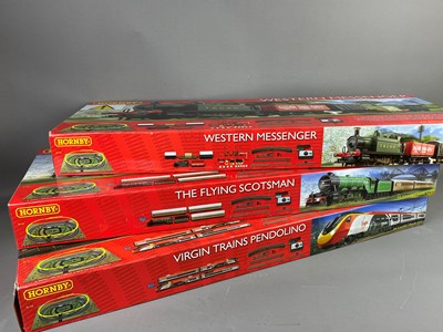 Lot 57A - A LOT OF HORNBY TRAIN SETS