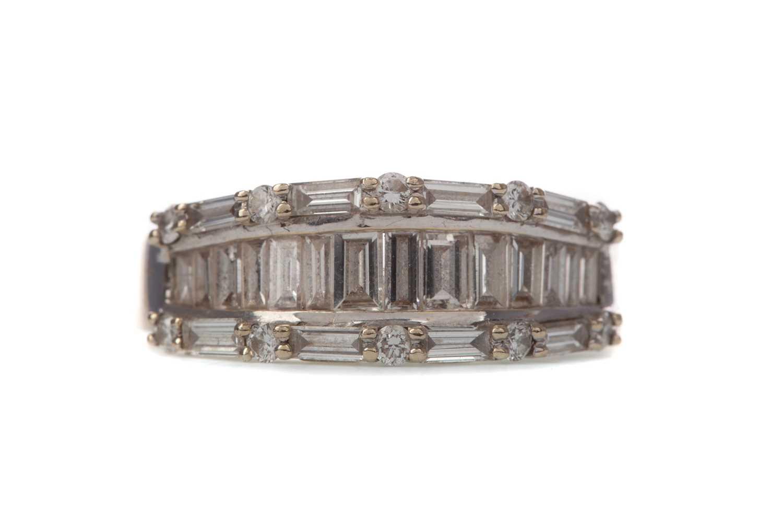 Lot 381 - A DIAMOND DRESS RING