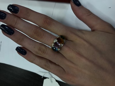 Lot 387 - A GEM SET AND DIAMOND RING
