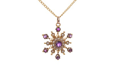 Lot 385 - AN AMETHYST AND SEED PEARL PENDANT