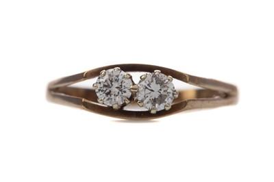 Lot 411 - A DIAMOND TWO STONE RING