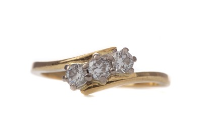 Lot 415 - A DIAMOND THREE STONE RING