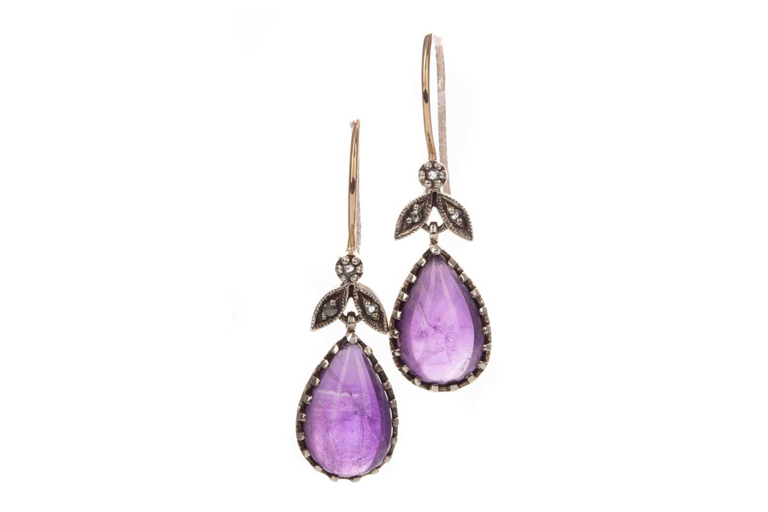 Lot 378 - A PAIR OF AMETHYST AND DIAMOND EARRINGS