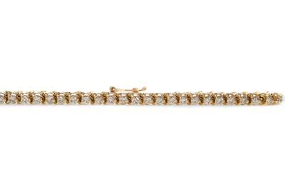 Lot 478 - A DIAMOND TENNIS BRACELET