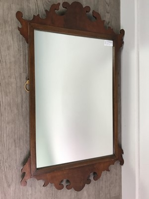 Lot 69 - A GEORGE III STYLE FRETTED MIRROR AND A MAHOGANY OPEN BOOKCASE