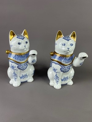 Lot 104 - A LOT OF TWO 'THE CAT OF GOOD FORTUNE' TEAPOTS