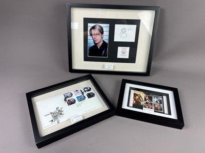 Lot 115 - A FRAMED DAVID BOWIE ROYAL MAIL FIRST DAY COVER, ALONG WITH OTHER FRAMED DAVID BOWIE MEMORABILIA