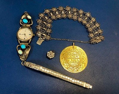 Lot 20A - A SILVER FILIGREE BRACELET, SILVER AND STONE SET WRIST WATCH, A MEDALLION AND A STONE SET CLUSTER PENDANT