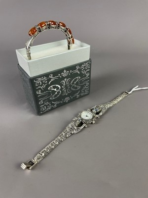 Lot 26 - A CONTINENTAL SILVER QUARTZ LADY'S FASHION WATCH ALONG WITH A SILVER AND BALTIC AMBER BRACELET